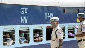 Police personnel look on as a train carrying migrants from Jaipur rolls into the Danapur station, Patna May 2, 2020(Santosh Kumar/ HTPhoto)