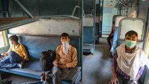 Migrants maintain social distance on a Shramik Express train that left Jalandhar for Daltonganj in Jharkhand on Tuesday.(PTI)