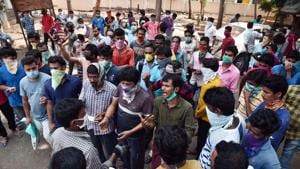Stranded migrant workers from other states arrive at the Mandal RevenueOffice, to ask theofficials to make arrangements for their transportationto go to their native places, during theongoing COVID-19 nationwide lockdown, in Vijayawada.(ANI)