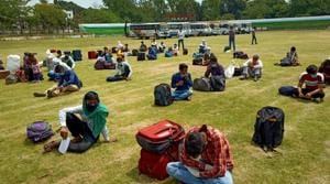 Over 240 migrant labourers who were going to their homes on foot were stopped by villagers and police in Shaktifarm area of US Nagar on Thursday.(HT PHOTO.)