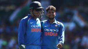 Kuldeep Yadav of India celebrates with MS Dhoni after taking the wicket of Shaun Marsh of Australia during game one of the One Day International series between Australia and India at Sydney Cricket Ground on January 12, 2019 in Sydney, Australia.(Getty Images)