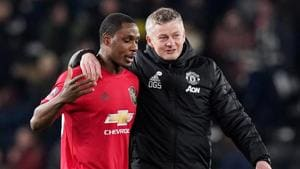 Manchester United manager Ole Gunnar Solskjaer celebrates with Odion Ighalo after the match.(REUTERS)