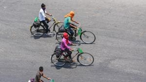 Migrants riding bicycles from Chennai on their way to their native places in Odisha pass through Vijayawada,.(PTI)