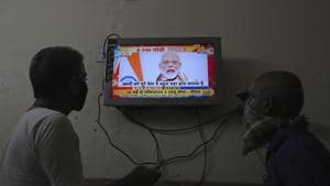 Indians watch a televised address to the nation by Prime Minister Narendra Modi in Hyderabad, India.(AP)