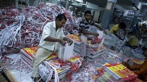 Printed cartons of fmcg majors rolling off the printing machines are sorted and labelled by the workers.