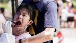 A child reacts while undergoing nucleic acid testing in Wuhan, the Chinese city hit hardest by the coronavirus disease (COVID-19) outbreak, Hubei province, China May 16, 2020. REUTERS/Aly Song(REUTERS)