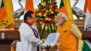 Prime Minister Narendra Modi (R) shakes hands with Sri Lankan Prime Minister Mahinda Rajapaksa after a joint statement at Hyderabad House, in New Delhi.(PTI/ File photo)