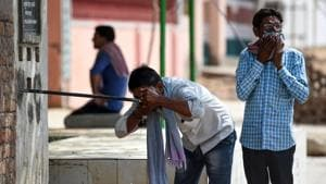 An Indian man drinks water from a roadside tap during a hot day in Churu, Rajasthan on June 4, 2019.(AFP)