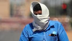 A man covers his face as he rides a bicycle during the heatwave in New Delhi on May, 25.(ANI)