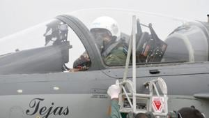 Tejas is an indigenous fourth generation tailless compound delta wing aircraft. Indian Air Force (IAF) chief Air Chief Marshal RKS Bhadauria can be seen preparing to take the aircraft for a sortie.(SOURCED)