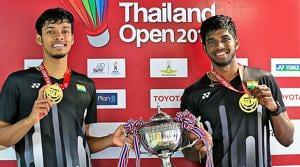 India's Satwiksairaj Rankireddy and Chirag Shetty pose with their medals and trophy after winning the Thailand Open 2019 badminton doubles title in Bangkok.(PTI)