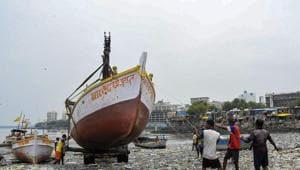 Mumbai: An earthmover carries a boat as fishermen prepare at Badhwar Park in Colaba ahead of the Cyclone Nisarga, in Mumbai(PTI)