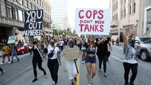 People take part in a protest in response to the death in Minneapolis police custody of George Floyd, in Los Angeles, California on Wednesday.(Reuters Photo)