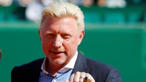 Boris Becker is awarded with the international tennis hall of fame ring to honour his career.(REUTERS)