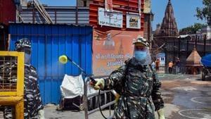A worker sanitises area around Kashi Vishwanath temple in Varanasi on Sunday.(PTI Photo)