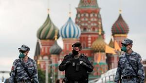 Russian law enforcement officers wearing protective face masks, used as a preventive measure against the spread of the coronavirus disease (COVID-19), walk at the annual Red Square Book Fair in central Moscow, Russia June 6, 2020. REUTERS/Shamil Zhumatov(REUTERS)