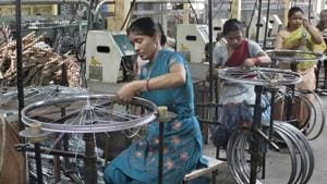 Workers in one of the cycle manufacturing units in Ludhiana.(JS Grewal/HT File Photo)