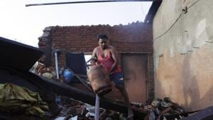 Maharashtra Deputy Chief Minister Ajit Pawar said that damage assessment has been done and the government will give Rs 15,000 each to the people whose slums were damaged.(AP file photo)