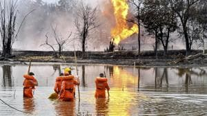 National Disaster Response Team (NDRF) personnel carry out search and rescue operations after two firemen of Oil India Limited went missing since an oil well at the company's Baghjan oilfield exploded in Assam's Tinsukia district on Wednesday.(PTI)