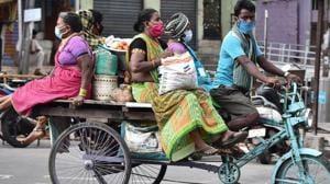 Women travelling in a rickshaw after buying daily essentials in Andhra Pradesh's Vijayawada .(ANI PHOTO.)