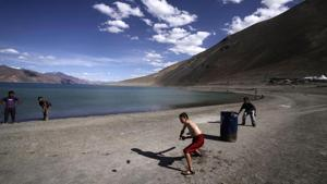 In this July 22, 2011, file photo, children play cricket by Pangong Lake, near the India-China border in Ladakh, India.(AP)