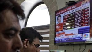 Indian stockbrokers watch the Bombay Stock Exchange (BSE) index on a trading terminal in Mumbai, India(AP)