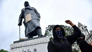 A demonstrator reacts infront of graffiti on a statue of Winston Churchill in Parliament Square during a Black Lives Matter protest in London following the death of George Floyd who died in police custody in Minneapolis, London on June 7, 2020.(Reuters File Photo)