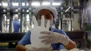 A worker carries out a test on a glove at a Top Glove factory in Meru outside Kuala Lumpur.(REUTERS File Photo)