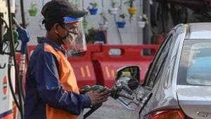 File photo: A petrol pump employee wearing a face shield while attending to a customer in Wazirpur, New Delhi.(Sanchit Khanna/HT PHOTO)