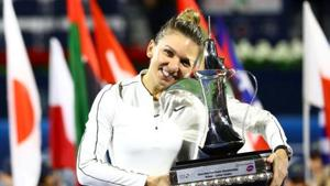 Romania's Simona Halep poses with a trophy as she celebrates after winning the final against Kazakhstan's Elena Rybakina(REUTERS)