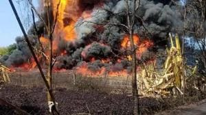Smoke emanating from oil wells after an explosion at the Baghjan oil field in Tinsukia district of Assam earlier this month.(ANI PHOTO.)