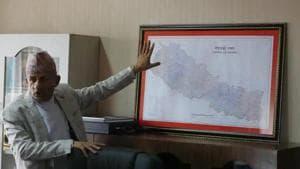 Nepal's foreign minister Pradeep Gyawali points to a map of Nepal in Kathmandu.(AP/ File photo)