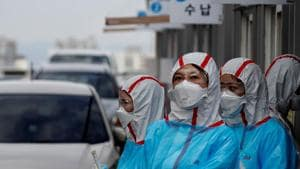 Medical staff in protective gear work at a 'drive-thru' testing center for the novel coronavirus disease of Covid-19 in Yeungnam University Medical Center in Daegu, South Korea.(Reuters Photo)