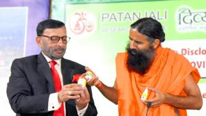 Baba Ramdev launching a medicine kit for Covid-19, in Haridwar on Tuesday.(ANI Photo)