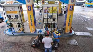 An employee attends to a customer at a petrol pump during unlock 1.0 process of the Covid-19 lockdown in Kolkata.(PTI File Photo)