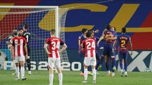 Barcelona's Ivan Rakitic celebrates scoring their first goal with teammates, as play resumes behind closed doors following the outbreak of the coronavirus disease (COVID-19).(REUTERS)