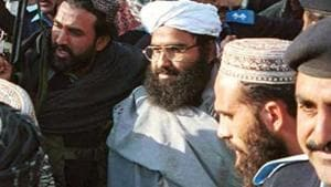 Leader of a militant group Masood Azhar, center wearing glasses and white turban, arrives in Islamabad, Pakistan.(AP)