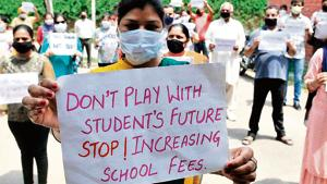 Parents protest in Chandigarh against fees charged by a private school during the lockdown period.(Ravi Kumar/HT Photo)