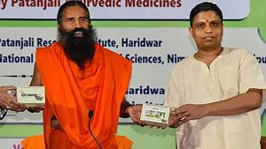 Baba Ramdev with Acharya Balkrishna launched an Ayurvedic medicine kit that they claimed can treat coronavirus patients within seven days on June 23, 2020.(@PypAyurved/Twitter Photo)