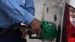 An employee of a petrol pump seen at work amid the lockdown in Nizamuddin, New Delhi on Wednesday, June 24, 2020.(Biplov Bhuyan/HT Photo)