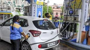 An employee fills fuel in a vehicle at a filling station.(PTI)