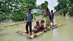 Villagers row a makeshift raft through a flooded field to reach a safer place at the flood-affected Mayong village in Morigaon district, in the northeastern state of Assam on June 29, 2020.(Reuters Photo)