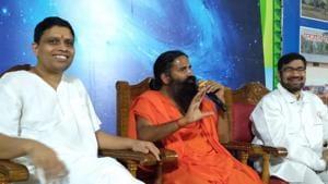 Baba Ramdev and Acharya Balkrishna addressing press conference in Haridwar on Wednesday.(HT PHOTO.)