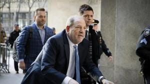 Harvey Weinstein arrives at a Manhattan courthouse as jury deliberations continue in his rape trial in New York. Weinstein and his former studio's board have reached a nearly $19 million settlement with dozens of his sexual misconduct accusers.(AP)