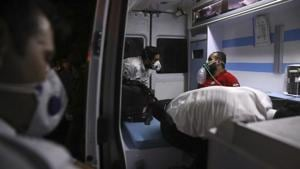 A rescue worker receives oxygen in an ambulance after he was overcome by smoke from the explosion of Sina Athar Clinic in Tehran, Iran, early Wednesday, July 1, 2020.(AP File Photo)