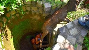 A spotted deer being rescued after it had fallen into a dry well in the in Malhan range of Dehradun forest division on Sunday.(HT PHOTO)