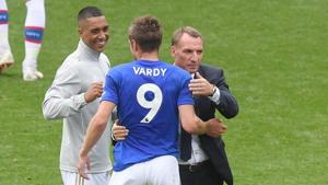 Leicester City's Jamie Vardy celebrates after the match with manager Brendan Rodgers.(REUTERS)