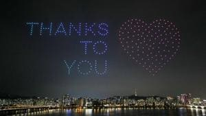 Drones fly over the Han river showing messages to support the country as a measure to avoid the spread of the coronavirus disease.(REUTERS/Yonhap)