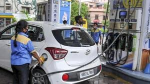 An employee fills fuel in a vehicle at a filling station, during fifth phase of Covid-19 lockdown in Kolkata.(PTI File Photo)