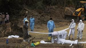 The video showed sanitation staff of the Tirupati Municipal Corporation lifting the body of the Covid-19 victim using the earth mover and dumping it into an already dug pit in the graveyard.(AP file photo. Representative image)